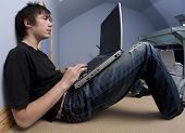 pic of 13 year old  - 13 year old boy teenager with laptop computer - JPG