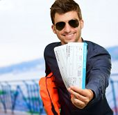 Happy Man Holding Life Jacket And Boarding Pass, Outdoors