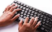 stock photo of backspace  - Two hands typing a black keyboard in white background - JPG