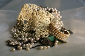 stock photo of collier  - a pile of pearl and other luxurious jewelry - JPG