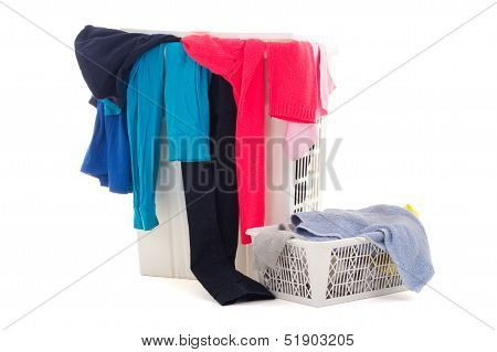Colorful Dirty Clothes In A Laundry Basket On White Background