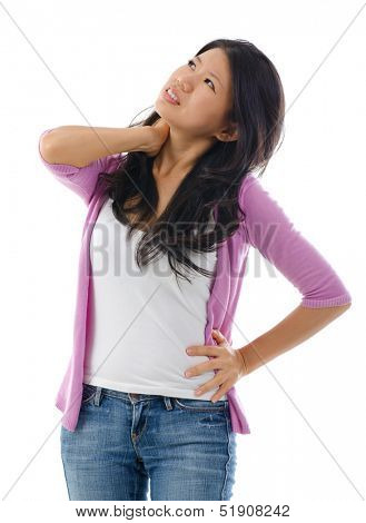 Tired Asian woman having neck and shoulder pain, standing isolated over white background.