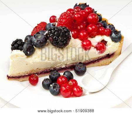 Piece of a pie with fresh berries