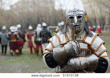 MOSCOW - APR 28: Warrior in armor and helmet at Battle of East - Russia-Orda XI-XV centuries on Maneuvers East versus West, Apr 28, 2013, Moscow, Russia.  Organizer of event - Paladin fencing center.