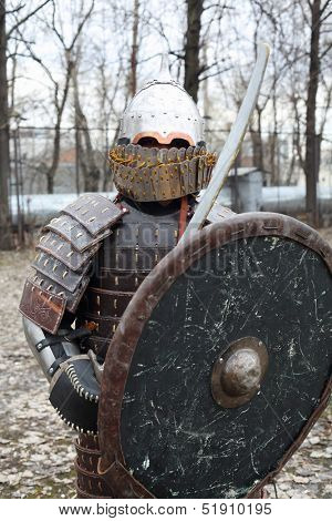MOSCOW - APRIL 28: East warrior with shield and sword on Maneuvers East versus West, on April 28, 2013 in Moscow, Russia. Prototype of maneuvers East vs. West  served Battle of Grunwald.