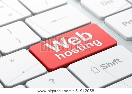 SEO web design concept: Web Hosting on computer keyboard backgro