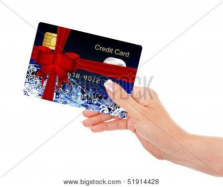 Hand Holding Christmas Credit Card Isolated Over White