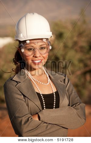 Young Woman In Hard Hat And Safety Goggles