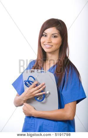 Female Nurse At A Desk Working In A Modern Office