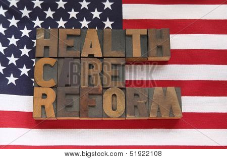 health care reform in wood type on flag