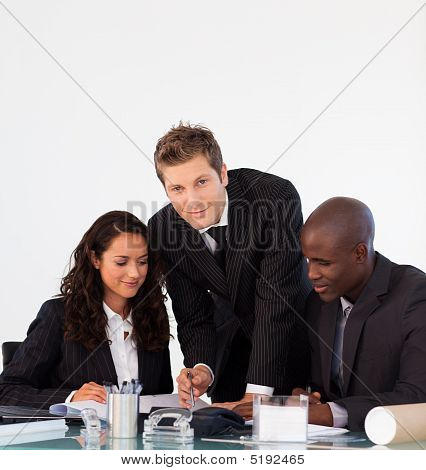 Business People Discussing In An Office And Looking At The Camera