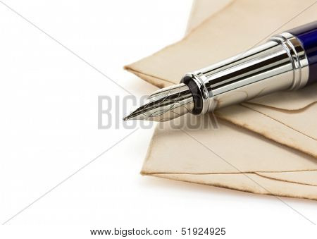 ink pen and aged paper isolated on white background