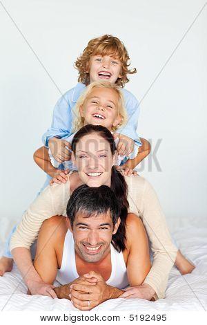 Family Having Fun In Bed