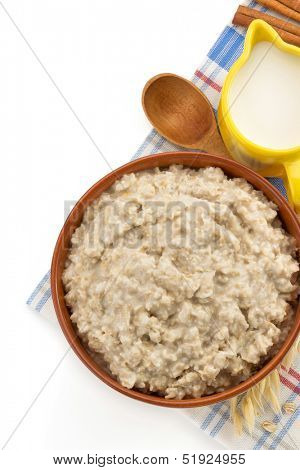 plate of oatmeal isolated on white background