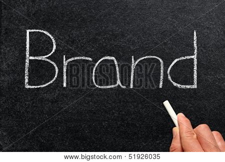 Brand, written on a blackboard.