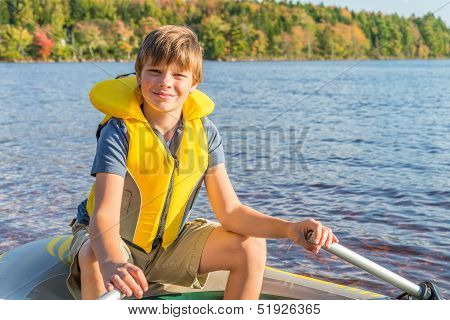 Boy In A Boat In Water