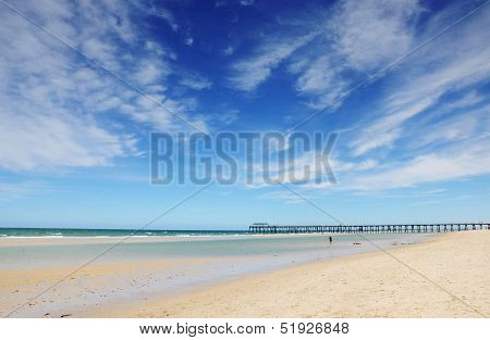 Beautiful Blue Sky Over Wide Sandy Beach With Jetty Pier In Background. Taken At Henley Beach, South