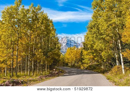 Snow-capped Maroon Bells in Full Fall Color
