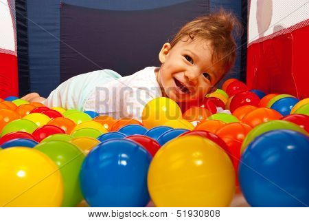 Happy Baby Laying On Balls