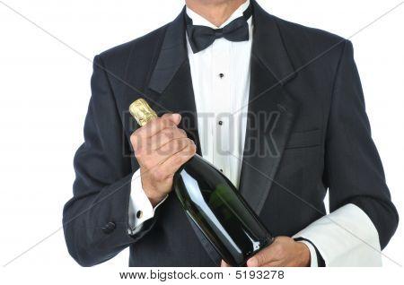 Sommelier Holding Bottle Of Champagne