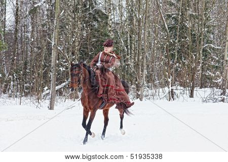 Woman in riding habit sits astride a bay Arab racer