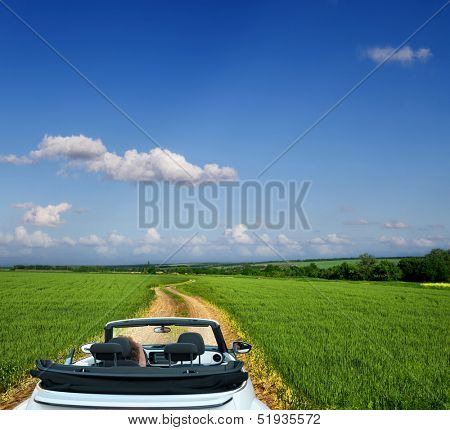 White convertible on a country road