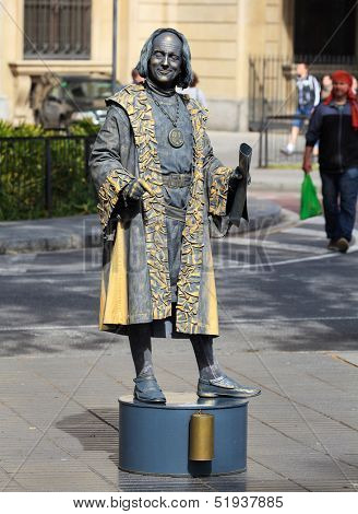 BARCELONA, SPAIN - APRIL 16: Human statue dressed as Christopher Columbus performing on La Rambla on April 16, 2013 in Barcelona, Spain. La Rambla is most popular street in Barcelona
