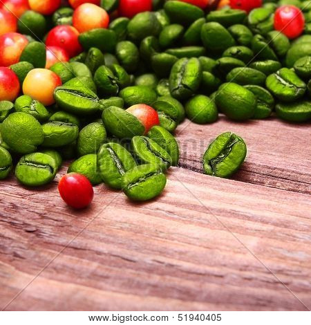 Green coffee beans on wooden background.