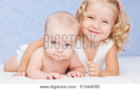 Happy Sister Hugging Baby Brother