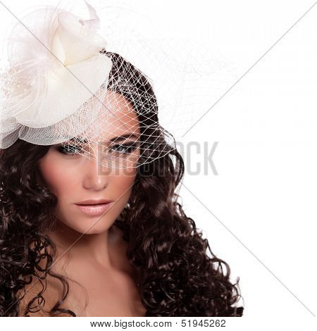 Closeup portrait of beautiful stylish bride isolated on white background, wearing hat with veil, sexy woman, fashion and style concept