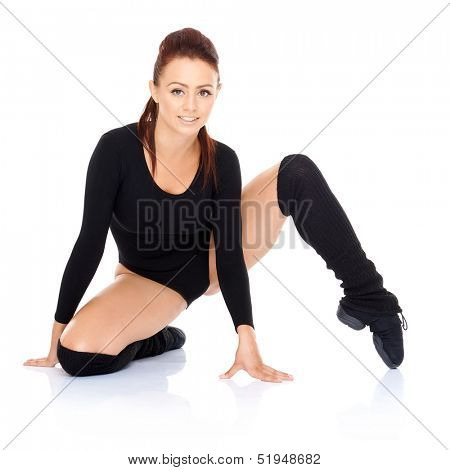 Athletic fit woman working out doing exercises stretching and toning her muscles to increase mobility and suppleness  on a white reflective background