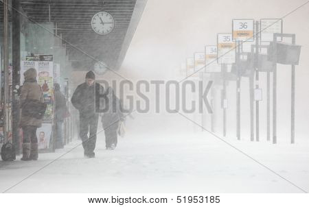 Helsinki, Finland - November 2012: People Walks Under Unexpected Heavy Snow On A Central Bus Station