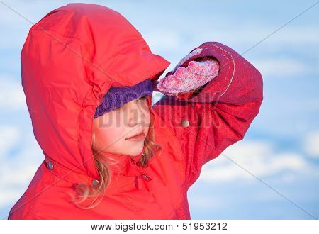 Little Ruddy Nice Girl In Winter Outwear With Hood Looks Into The Distance