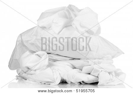 Rumpled bedding sheets and pillow isolated on white