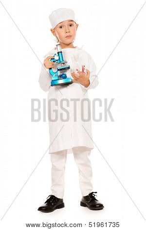 Full length portrait of cute smiling boy playing a doctor with microscope. Different occupations. Isolated over white.