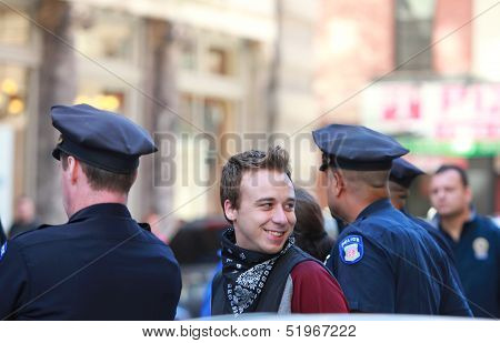Cheery Marcher Taken into NYPD Custody