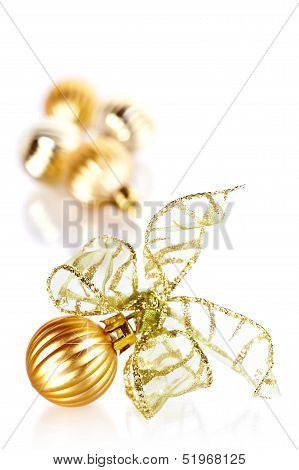 Christmas Gold Ball With A Bow.