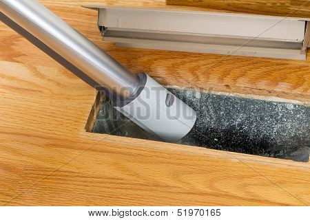 Cleaning Inside Heating Floor Vent With Vacuum Cleaner