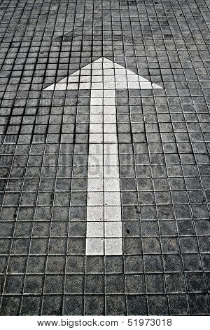 White Arrow On Pavement