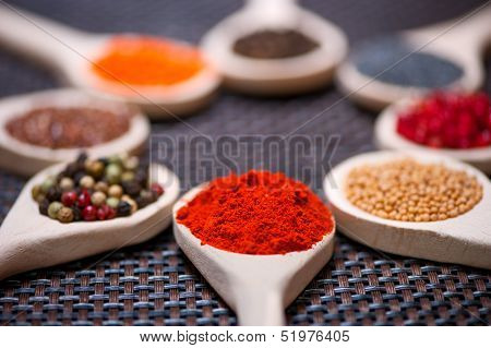 Various Kind Of Spices On Wooden Spoon -  Detail Of Chilli Powde