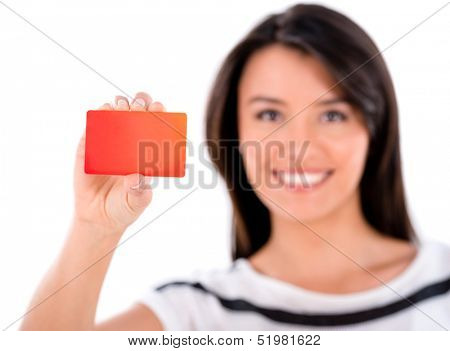 Happy woman holding a loyalty card - isolated over white background