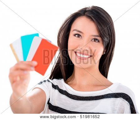Happy woman with a bunch of credit and debit cards - isolated over white
