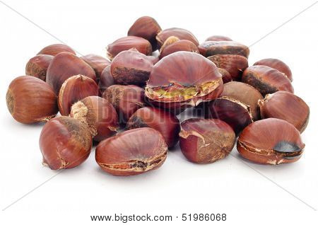 a pile of roasted chestnuts on a white background