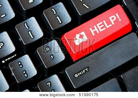 Red HELP button on a computer keyboard