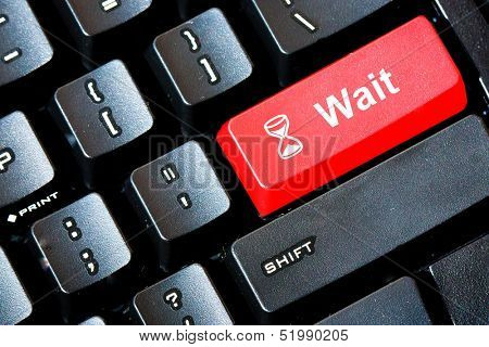 Red WAIT button on a computer keyboard