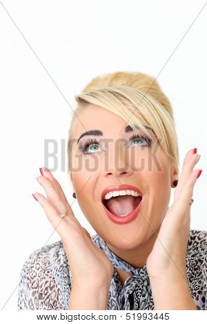 Beautiful blonde woman who is wearing greyish blouse looks very excited over a white background