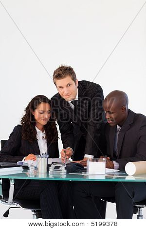 Business Team Talking To Each Other In A Meeting