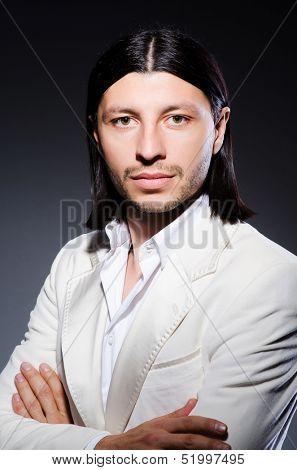 Handsome man against the dark background
