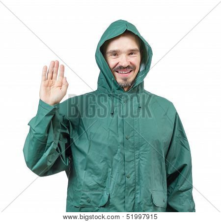 Caucasian Man In Hooded Rain Suit Waiving With Palm Isolated On White Background.