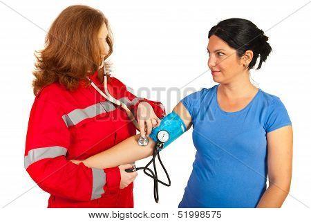 Paramedic Taking Blood Pressure